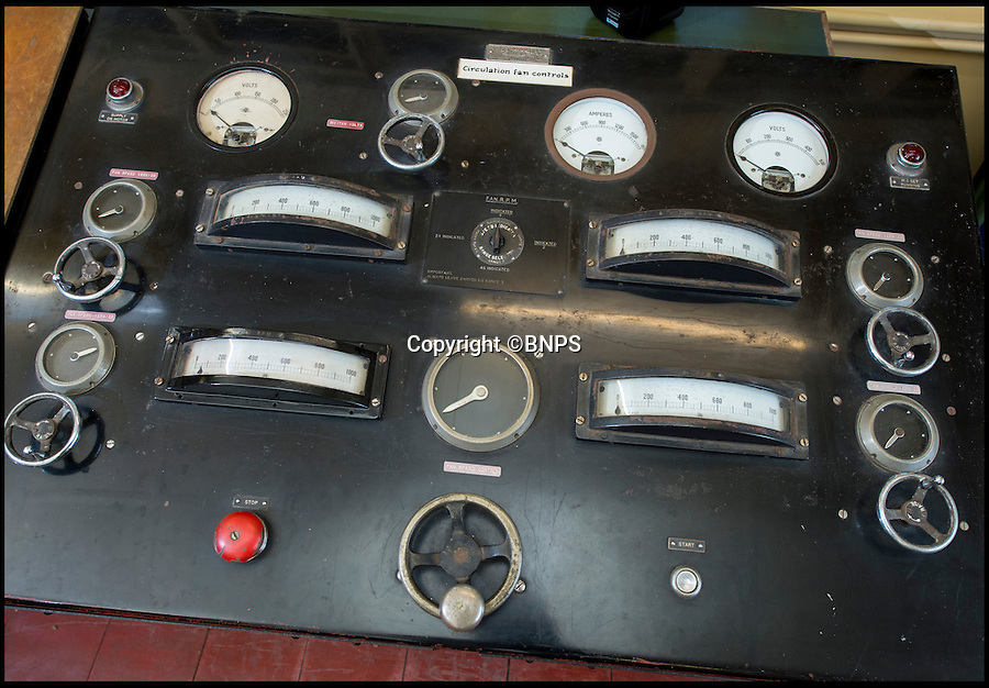 BNPS.co.uk (01202 558833)<br /> Pic: PhilYeomans/BNPS<br /> <br /> Antiquated looking control desk<br /> <br /> The coldest of Cold War relics has opened to the public after years of secrecy. <br /> <br /> Barnes Wallis's amazing Stratosphere Chamber was built at Brooklands in 1947 to test aircraft in high altitude conditions of flight.<br /> <br /> Constructed from the hull of a nuclear submarine the 340 ton structure could replicate temperatures down to -60 centigrade at 60,000 feet, as well as blasting rain, sleet or snow at 40 kts through the sealed chamber.<br /> <br /> As well as aircraft the facility was also used to test naval equipment in freezing arctic conditions, and even the effects of icing on trawler rigging.<br /> <br /> The gigantic structure, containing the cockpit of a Viscount passenger aircraft, has now been spruced up and is open to the public at the Brooklands Museum in Weybridge.
