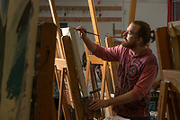 Ed Petersen paints during Tom Chung's Intermediate Painting class (ART A313) in UAA's Fine Arts Building.