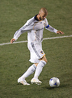 LA Galaxy midfielder and Captain David Beckham (23) dribblesl during the Super Clasico MLS match. The LA Galaxy defeated Chivas USA 5-2 during the SuperClasico at the Home Depot Center Stadium, in Carson, California, Saturday, April 26, 2008.