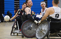 27 MAY 2013 - DONCASTER, GBR - Alan Ash (left) of the West Coast Crash attempts to pass across the court during the 2013 Great Britain Wheelchair Rugby Nationals bronze medal match against the South Wales Pirates at The Dome in Doncaster, South Yorkshire .(PHOTO (C) 2013 NIGEL FARROW)