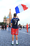 FIFA World Cup Football Russia 2018, Fans from Croatia and France are seen on the Red Square in front of Kremlin and St Basil's Cathedrale ahead of the final France vs Croatia on Sunday the 15th of July at Luzhniki stadium in Moscow. A French fan with a flag and an Antoine Griezmann jersey.