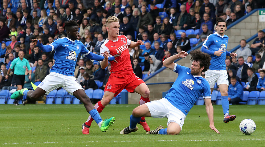 Fleetwood Town's Kyle Dempsey rides the challenge from Peterborough United's Michael Bostwick<br /> <br /> Photographer David Shipman/CameraSport<br /> <br /> The EFL Sky Bet League One - Peterborough United v Fleetwood Town - Friday 14th April 2016 - ABAX Stadium  - Peterborough<br /> <br /> World Copyright &copy; 2017 CameraSport. All rights reserved. 43 Linden Ave. Countesthorpe. Leicester. England. LE8 5PG - Tel: +44 (0) 116 277 4147 - admin@camerasport.com - www.camerasport.com