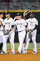 Gorkys Hernandez (9), Blake Tekotte (7) and Jared Mitchell (21) high five teammates after their win over the Durham Bulls at BB&T Ballpark on April 24, 2014 in Charlotte, North Carolina.  The Knights defeated the Bulls 4-3.  (Brian Westerholt/Four Seam Images)