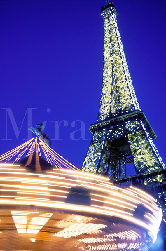France, Paris, The Eiffel Tower illuminated and carousel