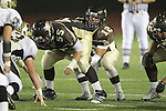 Torrance, CA 11/05/10 - Robbie Villa (West # 55) and Austin Watters (West # 12) in action during the Peninsula vs West varsity football game played at West Torrance high school.