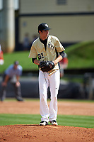 UCF Knights relief pitcher Thaddeus Ward (32) gets ready to deliver a pitch during a game against the Siena Saints on February 21, 2016 at Jay Bergman Field in Orlando, Florida.  UCF defeated Siena 11-2.  (Mike Janes/Four Seam Images)