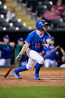 Oklahoma City Dodgers first baseman Max Muncy (13) follows through on a swing during a game against the Colorado Springs Sky Sox on June 2, 2017 at Chickasaw Bricktown Ballpark in Oklahoma City, Oklahoma.  Colorado Springs defeated Oklahoma City 1-0 in ten innings.  (Mike Janes/Four Seam Images)