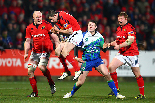23.03.2013 Cork, Ireland. Felix Jones (Munster), gathers a loose ball, during the Rabodirect Pro 12 game between Munster and Connacht from Musgrave Park.