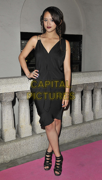 Nathalie Emmanuel.attended the Inspiration Awards For Women, Cadogan Hall, Sloane Terrace, London, England, UK, October 7th 2011..full length black dress hand on hip strappy sandals .CAP/CAN.©Can Nguyen/Capital Pictures.