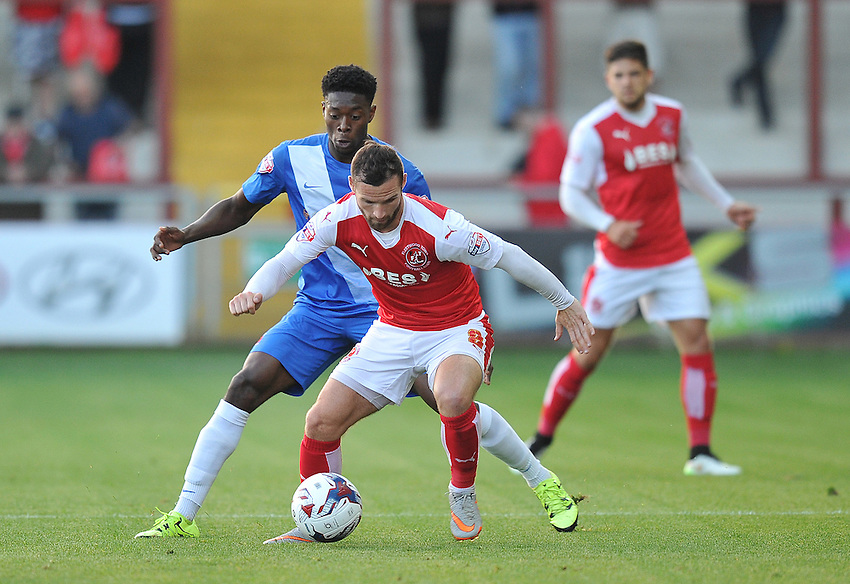 Fleetwood Town's Jimmy Ryan battles with Hartlepool United's Rakish Bingham<br /> <br /> Photographer Dave Howarth/CameraSport<br /> <br /> Football - Capital One Cup First Round - Fleetwood Town v Hartlepool United - Tuesday 11th August 2015 - Highbury Stadium - Fleetwood<br />  <br /> &copy; CameraSport - 43 Linden Ave. Countesthorpe. Leicester. England. LE8 5PG - Tel: +44 (0) 116 277 4147 - admin@camerasport.com - www.camerasport.com