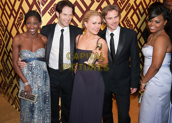RUTINA WESLEY, STEPHEN MOYER, ANNA PAQUIN & SAM TRAMMELL.The HBO Party following the 66th Annual Golden Globe Awards at the Beverly Hilton in Beverly Hills, California, USA..January 11th, 2009.globes award winner full 3/4 length trophy black suit jacket strapless purple blue pattern dress.*Editorial Use Only*.CAP/AWF/HFPA.Supplied by Capital Pictures.