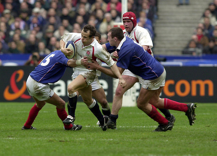 Photo.Richard Lane.France v England at Stade de France. 2-3-2002. Lloyds TSB Six Nations Championship..Austin Healey is tackled by Tony Marsh (lt) and Olivier Brouzet(rt).