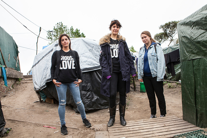 """left to right Dani Lawrence, Liana Bird and Josie Naughton who are the main figures of Help Refugees UK.  Photographed in """"The Jungle"""" refugee camp in Calais France. Help Refugees has grown out of #helpcalais, a social media campaign started by Lliana Bird (Radio X DJ), Dawn O'Porter (Writer and Presenter), Josie Naughton and Heydon Prowse (The Revolution will be Televised) to raise a few funds and collect goods to take to Calais to help in some small way. The public response to the campaign was huge, and we were quickly able to provide aid in Calais and far beyond. Dani Lawrence' involvement begin when she filled a car with supplies and donations and drove to Calais."""