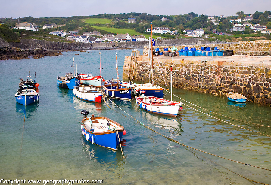 Small fishing boats in the harbour at the village of Coverack on the Lizard peninsula, Cornwall, England