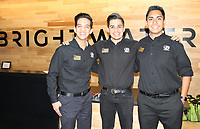 NWA Democrat-Gazette/CARIN SCHOPPMEYER Luis Gallardo (from left), Angel De La Calleros ans Emanuel Garcia Peralta, Northwest Arkansas Community College hospitality students, welcome guests to the Plant a Seed benefit April 27 at Brightwater: A Center for the Study of Food in Bentonville.
