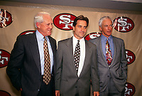 SANTA CLARA, CA: New San Francisco 49ers head football coach Steve Mariucci (center) is introduced to the media at a press conference in Santa Clara, CA in 1996 with former coaches Bill Walsh (left) and George Seifert. Photo by Brad Mangin