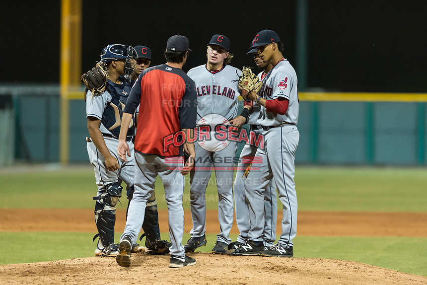AZL Indians 2 pitching coach Owen Dew (38) talks to starting pitcher Carlos Vargas (64) along with Noah Naylor (12), Brayan Rocchio (24), Raynel Delgado (32), and Gionti Turner (10) during a mound visit in an Arizona League game against the AZL Cubs 2 at Sloan Park on August 2, 2018 in Mesa, Arizona. The AZL Indians 2 defeated the AZL Cubs 2 by a score of 9-8. (Zachary Lucy/Four Seam Images)