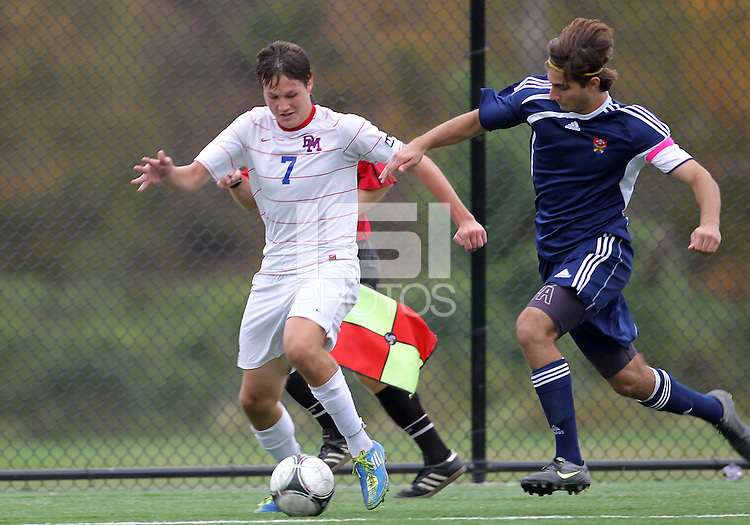 HYATTSVILLE, MD - OCTOBER 26, 2012:  Christian Cooke (7) of DeMatha Catholic High School moves the ball away from Camyer Matini (5) of St. Albans during a match at Heurich Field in Hyattsville, MD. on October 26. DeMatha won 2-0.