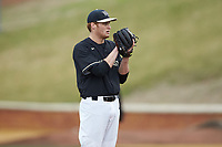 Wake Forest Demon Deacons starting pitcher Colin Peluse (8) looks to his catcher for the sign against the Illinois Fighting Illini at David F. Couch Ballpark on February 16, 2019 in  Winston-Salem, North Carolina.  The Fighting Illini defeated the Demon Deacons 5-2. (Brian Westerholt/Four Seam Images)