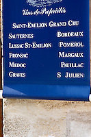 Wine shop with sign: Saint Emilion Grand Cru, Sauternes, Bordeaux, Lussac-St-Emilion, Pomerol, Fronsac, Margaux, Pauillac, Medoc, Graves, St Julien. The town. Saint Emilion, Bordeaux, France