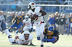 BROOKINGS, SD - NOVEMBER 11: Malachi Broadnax #5 from Illinois State tries to slip the diving grasp of Kellen Soulek #94 from South Dakota State University during their game Saturday afternoon at Dana J. Dykhouse Stadium in Brookings. (Photo by Dave Eggen/Inertia)