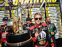 Sep 16, 2018; Mohnton, PA, USA; NHRA top fuel driver Leah Pritchett poses next to the championship trophy during the Dodge Nationals at Maple Grove Raceway. Mandatory Credit: Mark J. Rebilas-USA TODAY Sports
