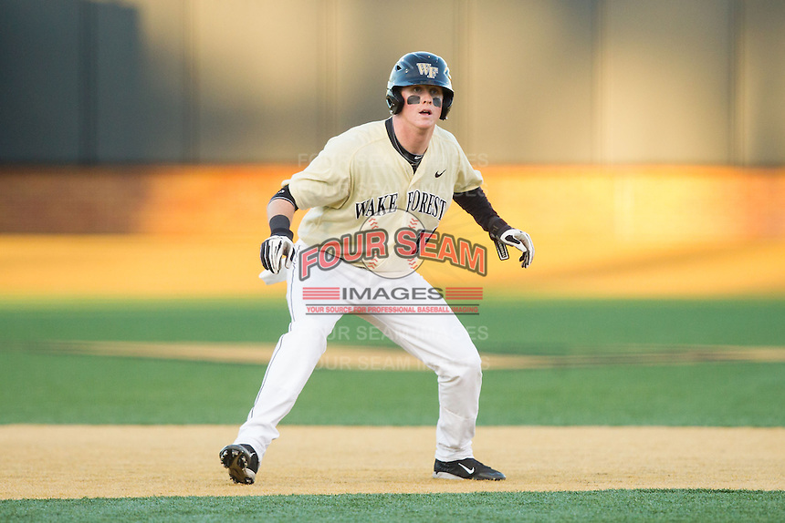 Conor Keniry (14) of the Wake Forest Demon Deacons takes his lead off of second base against the Cincinnati Bearcats at Wake Forest Baseball Park on February 21, 2014 in Winston-Salem, North Carolina.  The Bearcats defeated the Demon Deacons 5-0.  (Brian Westerholt/Four Seam Images)