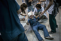 An injured protester gets medical emergency treatment at a makeshift hospital as clashes sparked out with the anti-riot police in the streets nearby Taksim Square during a masive rally against the turkish government in Istanbul, Turkey.