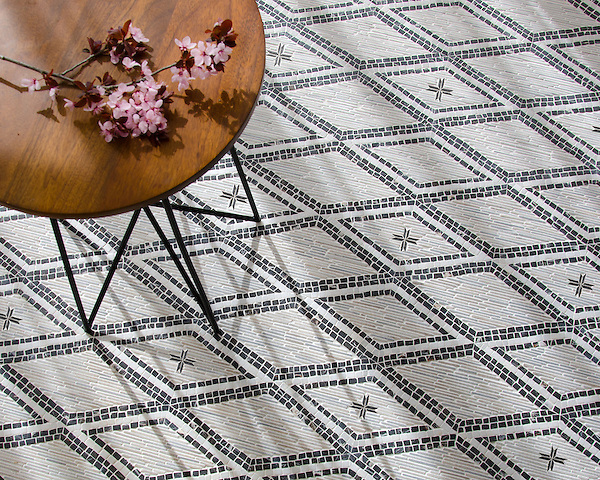 Rimini, a hand-cut stone mosaic, shown in hand-chopped tumbled Cashmere, Afyon White, and Saint Laurent, was designed by Paul Schatz as part of the Legend collection for New Ravenna.