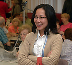 Newsday reporter Chau Lam at the Cannatore Senior Citizen Center in Smithtown on Friday June 30, 2006, to cover Governor George Pataki's appearance for the signing of legislation providing Tax Rebates to homeowners enrolled in the STAR Program. (Newsday Photo / Jim Peppler).