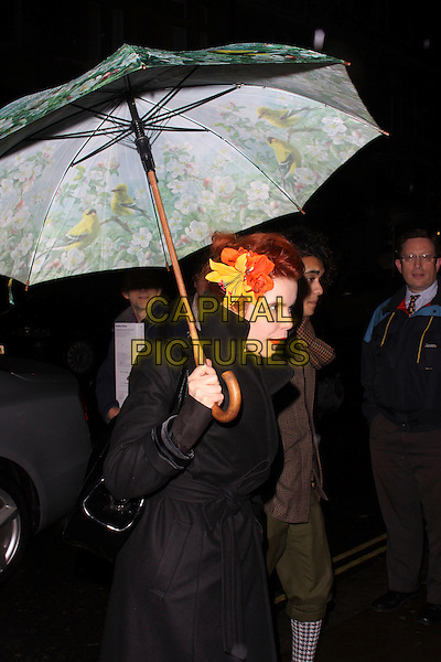 PALOMA FAITH.Attending the Gala Performance of the English National Ballet's 'The Nutcracker' at the Coliseum, London, England, UK..December 15th 2010.half length black coat umbrella red orange flower in hair profile.CAP/AH.©Adam Houghton/Capital Pictures.