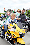 """Teacher Claire Bexon with her family Charlie, Emily and Paul before the """"Run of the Country"""" Motorcycle fundraiser at St.Itas school...(Photo credit should read Jenny Matthews www.newsfile.ie)....This Picture has been sent you under the conditions enclosed by:.Newsfile Ltd..The Studio,.Millmount Abbey,.Drogheda,.Co Meath..Ireland..Tel: +353(0)41-9871240.Fax: +353(0)41-9871260.GSM: +353(0)86-2500958.email: pictures@newsfile.ie.www.newsfile.ie."""