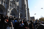Mourners gather on the steps of St. Sabina's as doves are released after the funeral of Tyshawn Lee, 9, who was shot multiple times while playing basketball in an alley on November 2, 2015, in Chicago, Illinois on November 10, 2015. Police allege the killing was a retaliatory gang hit which would mark a new turn in Chicago's gang wars.