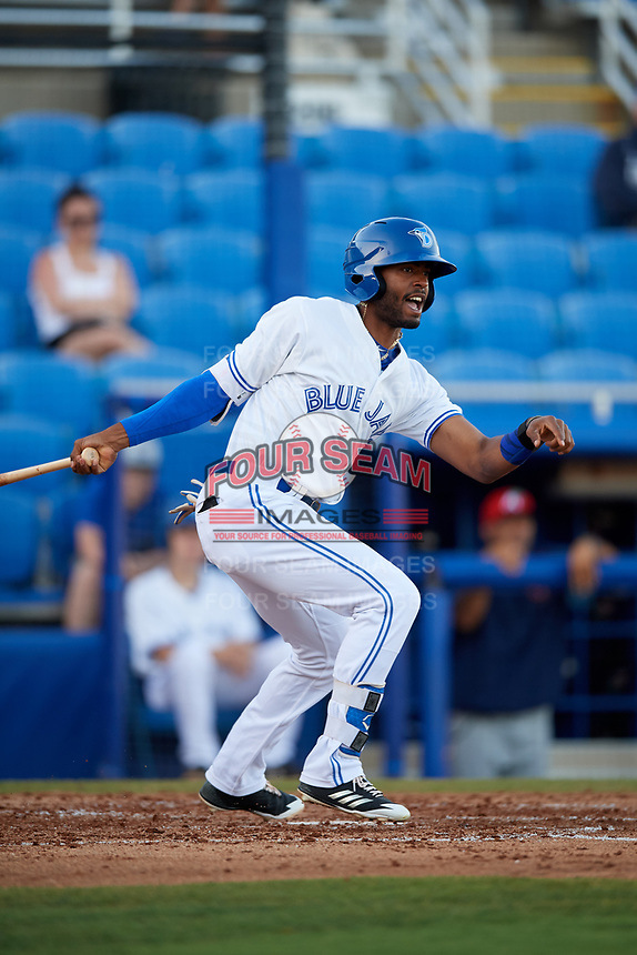 Dunedin Blue Jays right fielder Joshua Palacios (7) follows through on a swing during a game against the Fort Myers Miracle on April 17, 2018 at Dunedin Stadium in Dunedin, Florida.  Dunedin defeated Fort Myers 5-2.  (Mike Janes/Four Seam Images)