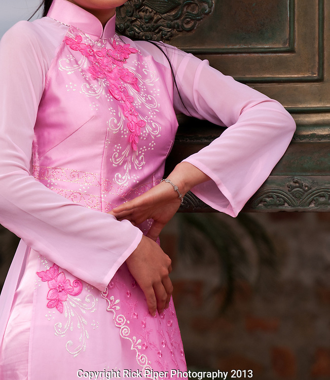 Ao Dai 07.Vietnamese woman wearing a pink traditional Ao Dai, Hanoi, Vietnam