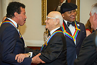 Lionel Richie, left, shares an embrace with Norman Lear, left center, while LL COOL J, center right, converses with United States Secretary of State Rex Tillerson, right, prior to the five recipients of the 40th Annual Kennedy Center Honors posing for a group photo following a dinner hosted by Secretary Tillerson in their honor at the US Department of State in Washington, D.C. on Saturday, December 2, 2017.  The 2017 honorees are: American dancer and choreographer Carmen de Lavallade; Cuban American singer-songwriter and actress Gloria Estefan; American hip hop artist and entertainment icon LL COOL J; American television writer and producer Norman Lear; and American musician and record producer Lionel Richie. Photo Credit: Ron Sachs/CNP/AdMedia