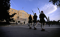 02 NOV 2003 - ATHENS, GREECE - Evzones march into the square in front of the Vouli Parliament building as the sun begins to set. (PHOTO (C) NIGEL FARROW)