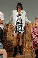 """Model poses in an outfit from the Private Policy Spring Summer 2018 """"Trinkets"""" collection, for New York Mens Day at Dune Studios on July 10, 2017; duing New York Fashion Week: Mens Spring Summer 2018."""