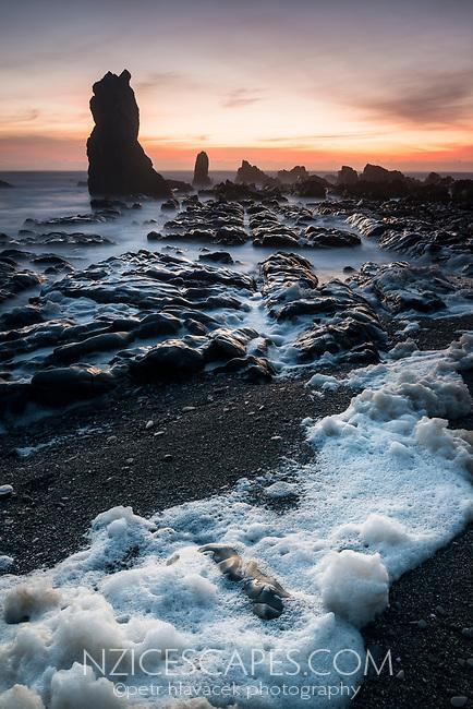 Rocky formations on wild coast near Rapahoe near Greymouth, West Coast, New Zealand, NZ
