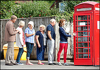 BNPS.co.uk (01202 558833)<br /> Picture: Laura Jones<br /> <br /> Shhh... Quiet please!<br /> <br /> Residents of a sleepy rural village have opened a library in their old phone box. The iconic red BT kiosk in Kington Magna near Gillingham, Dorset,  was bought by the parish council for only a &pound;1 and is thought to be the country's smallest library. After stripping it of it's phone the village's 400 residents donated books. The former phone box now houses a collection of 300 books of all genres crammed onto its 16 shelves and is open 24 hours a day.