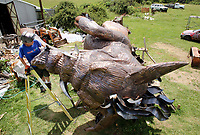NWA Democrat-Gazette/DAVID GOTTSCHALK Artist Eugene Sargent continues to work on the stout area of a 25 foot tall boar Wednesday, June 6, 2018, at his studio in rural Washington County. The boar is commissioned by Cliff Slinkard with Hogeye Inc. and will be installed Sunday, June 10, 2018 and a five foot tall base at the company office at 4148 West Matin Luther King Jr. Boulevard in Fayetteville.