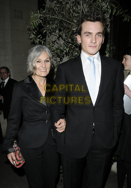 RUPERT FRIEND & MOTHER .The Laurence Olivier Awards 2010, Grosvenor House Hotel, London, England. .21st March 2010.half length black suit jacket red clutch bag son mom mum family .CAP/CAN.©Can Nguyen/Capital Pictures.