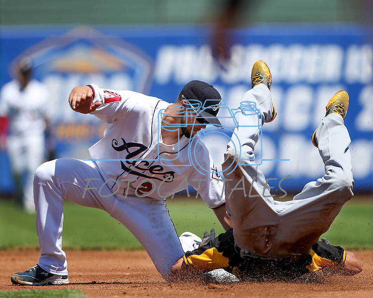 Reno Aces' Sean Jamieson puts the tag on Salt Lake Bees' Quintin Berry at Greater Nevada Field in Reno, Nev., on Tuesday, June 7, 2016. <br />Photo by Cathleen Allison