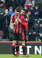 Lys Mousset of AFC Bournemouth embraces Nathan Ake of AFC Bournemouth at full time during the Premier League match between Bournemouth and Arsenal at the Goldsands Stadium, Bournemouth, England on 14 January 2018. Photo by Andy Rowland.