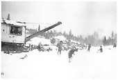 New Mexico Lumber Co.'s American log loader and crew loading logging cars on a snowy day.<br /> New Mexico Lumber Co.  San Juan National Forest, CO  Taken by Long, Morris - ca. 1926-1929