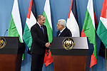 Palestinian President Mahmoud Abbas shakes hands with Bulgarian President Rumen Radev during a joint press conference in the West Bank city of Ramallah on March 22, 2018. Photo by Thaer Ganaim