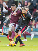 17th March 2018, Tynecastle Park, Edinburgh, Scotland; Scottish Premier League football, Heart of Midlothian versus Partick Thistle;  Christophe Berra of Hearts and Martin Boyle of Hibernian contest for the ball