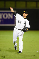 Salt River Rafters outfielder Trayce Thompson #24, of the Chicago White Sox organization, warms up before an Arizona Fall League game against the Mesa Solar Sox at Salt River Fields at Talking Stick on October 9, 2012 in Scottsdale, Arizona.  Salt River defeated Mesa 6-5.  (Mike Janes/Four Seam Images)