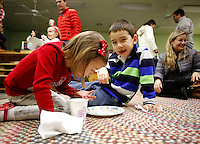 NWA Media/DAVID GOTTSCHALK - 12/19/14 - Kayla Undernehr (cq), 4, left, and her brother David Undernehr, 6, enjoy cookies in the classroom of Jamie VanHorn and Amy Davis during the Winter Solstice Celebration at Walnut Farm Montessori School in Bentonville Friday December 20, 2014. The school held a celebration inviting friends and family to enjoy cookies, cider, hot chocolate and listen to songs and poems by the students and faculty in the Natural Playground.