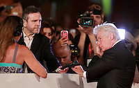 "L'attore statunitense Richard Gere parla con i giornalisti sul red carpet per la presentazione del film ""Time Out of Mind"" al Festival Internazionale del Film di Roma, 19 ottobre 2014.<br /> U.S. actor Richard Gere speaks with journalist on the red carpet to present the movie ""Time Out of Mind"" during the international Rome Film Festival at Rome's Auditorium, 19 October.<br /> UPDATE IMAGES PRESS/Isabella Bonotto"